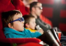 a family watching a movie at the cinema