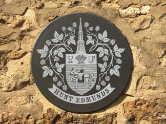 an old hunt edmunds brewery plaque embedded in a wall