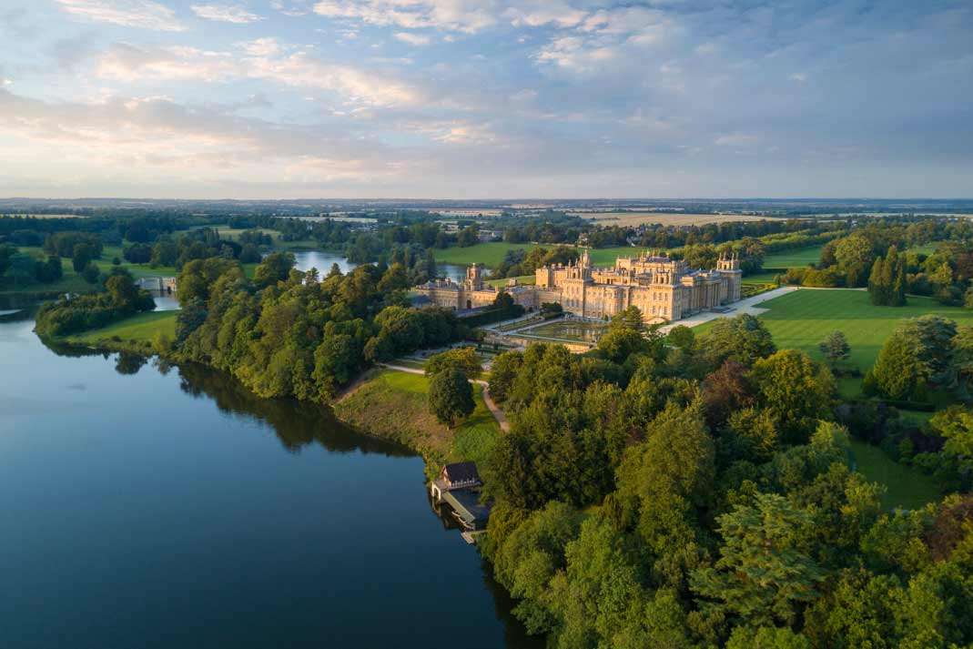 the majestic view of blenheim palace and it's pools from above