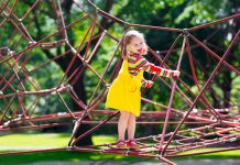 girl having fun on a climbing web