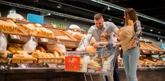 a family shopping at a supermarket bakery