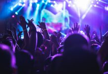 crowd with hands in the air at a music festival