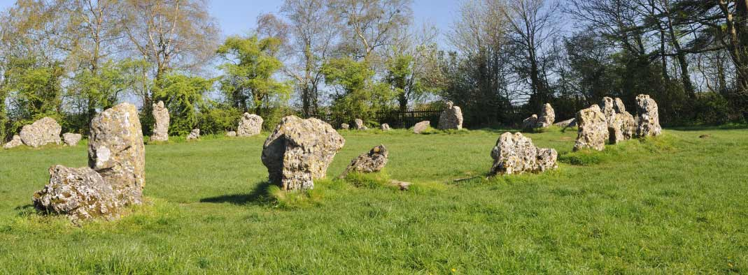 the ancient rollright standing stones in the sun
