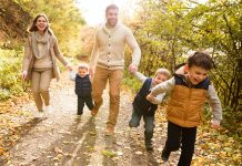 a family walking through the countryside in autumn