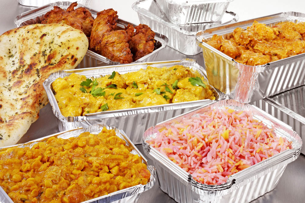 various boxes of Indian takeaway dishes