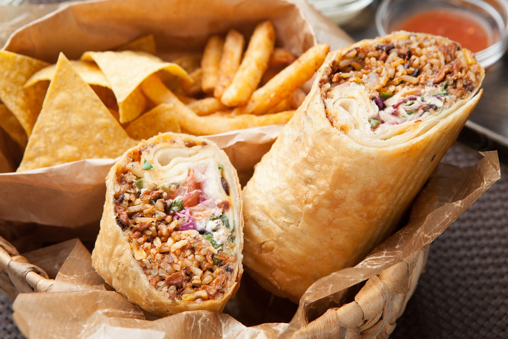 a mexican burrito wrap with fries