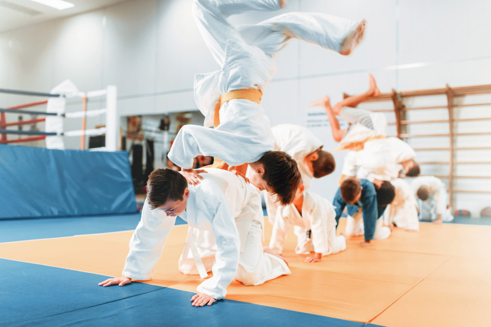 kids practising judo in a sports hall