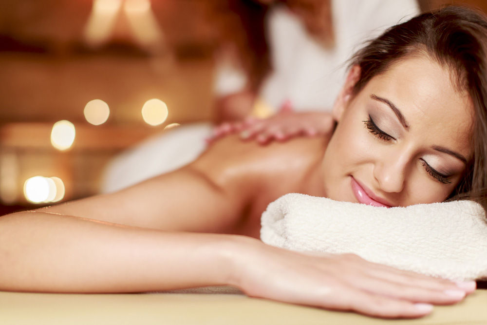 woman receiving a body massage at a spa retreat