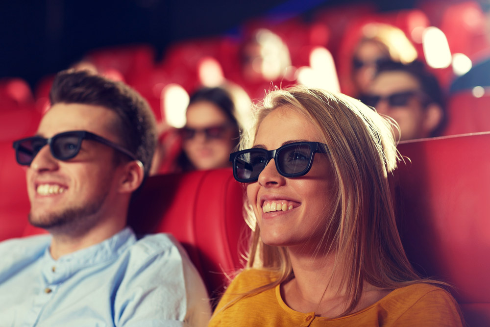 a couple at the cinema enjoying the 3D movie