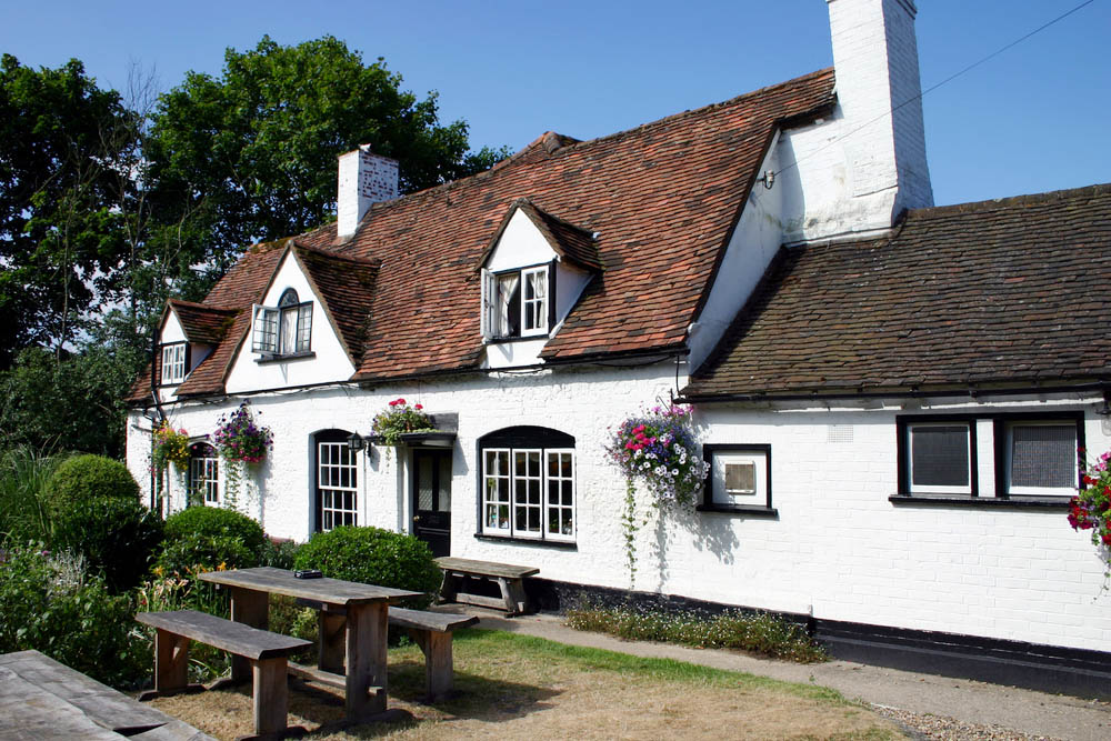 outside entrance to a traditional British pub in the sunshine