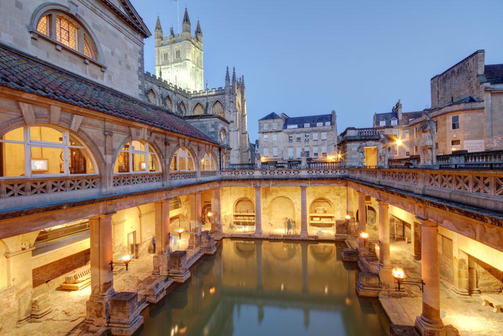 the roman baths at dusk in the city of bath