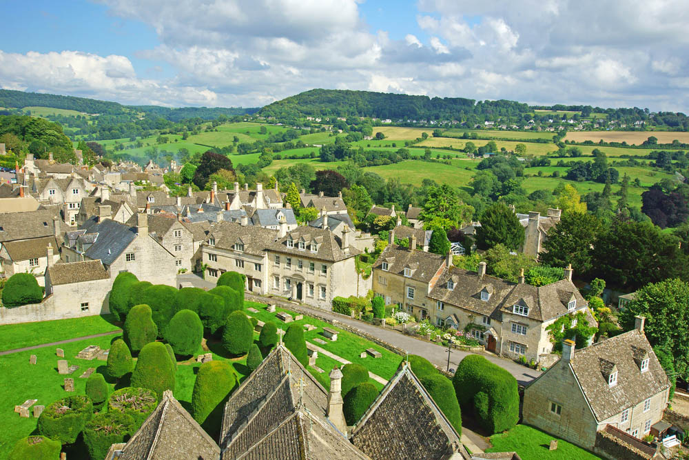 a glorious landscape view of the hills surrounding a cotswold village
