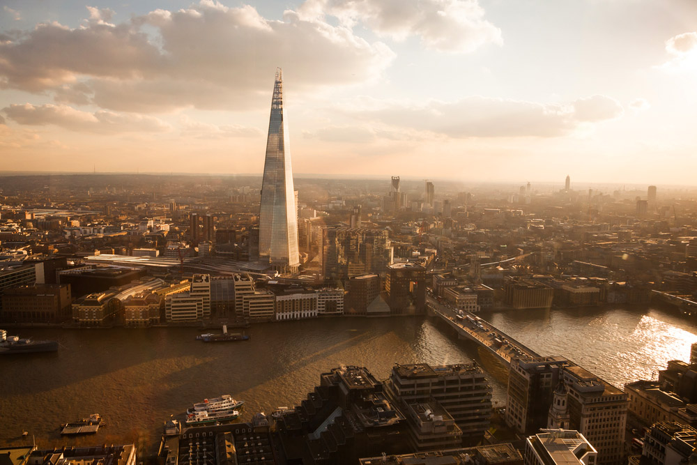 the shard building towering over the london skyline at dusk