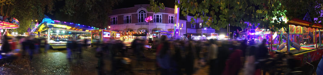 a panoramic photo of the crowd at banbury's michaelmas funfair