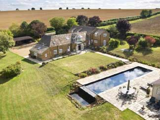 aerial view of beggars barn house with the pool and 3.5 acres of land